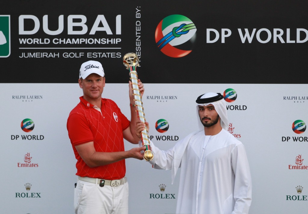DUBAI, UNITED ARAB EMIRATES - NOVEMBER 28:  Robert Karlsson of Sweden poses with the trophy alongside His Highness Sheikh Majid bin Mohammed bin Rashid al Maktoum (Chairman of the Dubai Culture and Arts Authority) after winning the Dubai World Championship on the Earth Course, Jumeirah Golf Estates on November 28, 2010 in Dubai, United Arab Emirates.  (Photo by Andrew Redington/Getty Images)