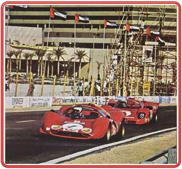 David Piper and Nick Mason racing past the Hyatt Regency Hotel in a supporting event for Dubai Motor Racing Grand Prix 1981.